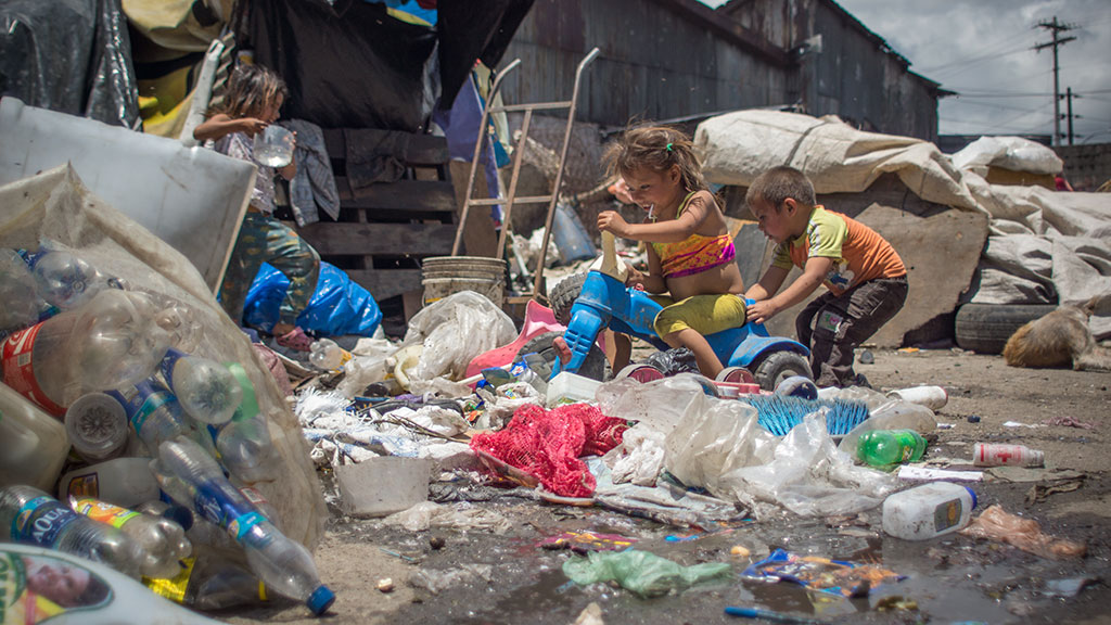 Children Playing at the Terminal Dump in Guatemala City. Photo by Scott Owen Moore.